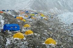 Everest Base Camp tents on Khumbu glacier EBC, Nepal side. Khumbutse overlooks a sprinkling of colored tents EBC, Nepal side. Nepalese south Everest Base Camp Royalty Free Stock Photo