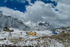 Everest Base Camp tents on Khumbu glacier EBC, Nepal side. Khumbutse overlooks a sprinkling of colored tents EBC, Nepal side. Nepalese south Everest Base Camp Royalty Free Stock Photography