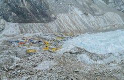 Everest Base Camp tents on Khumbu glacier EBC, Nepal side. Khumbutse overlooks a sprinkling of colored tents EBC, Nepal side. Nepalese south Everest Base Camp Stock Photos