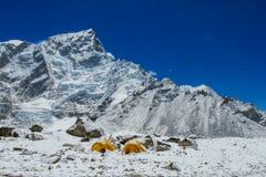 Everest Base Camp tents on Khumbu glacier EBC, Nepal side. Khumbutse overlooks a sprinkling of colored tents EBC, Nepal side. Nepalese south Everest Base Camp Stock Images