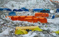 Everest Base Camp tents on Khumbu glacier EBC, Nepal side. Khumbutse overlooks a sprinkling of colored tents EBC, Nepal side. Nepalese south Everest Base Camp Royalty Free Stock Image