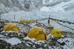 Everest Base Camp tents on Khumbu glacier EBC, Nepal side. Khumbutse overlooks a sprinkling of colored tents EBC, Nepal side. Nepalese south Everest Base Camp Stock Photo