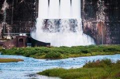 Khun Dan Prakan Chon Dam with open spillway, Thailand