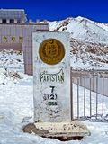 Pakistani border stele at Khunjerab Pass, Pakistan, China. The Khunjerab Pass, with an elevation of 5,000 metres or 16,000 feet, is a high mountain pass in the royalty free stock photo