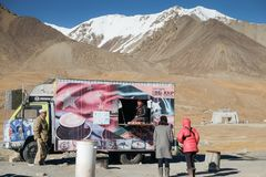 Women tourists talking with a man selling food at the Pak-China border. stock photography
