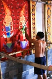 Khunpepe. Phatthalung, THAILAND - May 22, 2012: A Muralist restores a painting on the wall in Wat Ban Suan temple, Phatthalung,Thailand Royalty Free Stock Photos