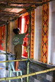 Khunpepe. Phatthalung, THAILAND - May 22, 2012: A Muralist restores a painting on the wall in Wat Ban Suan temple, Phatthalung,Thailand Royalty Free Stock Photography