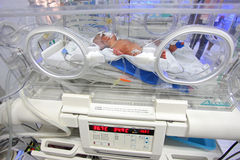 Khunpepe026. Nakhon Si Thammarat, Thailand - January 23, 2011 : A premature newborn rests in an incubator at Maharat Hospital Royalty Free Stock Image