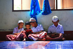 Khunpepe038. Krabi, Thailand - OCTOBER 29, 2012 : A small group of Muslim boys attend religion school session to read Koran in a local mosque Stock Photo