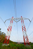 Khunpepe052. Electricity pylons against blue sky Royalty Free Stock Photos