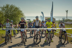 KHVALYNSK - MAY 9, 2016: Group of cyclists at highland marathon track championship 'Match of Russian cities'. royalty free stock image