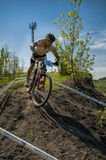 KHVALYNSK - MAY 7, 2016: Male cyclist rides at XCE eliminator track championship 'Match of Russian cities'. KHVALYNSK - MAY 7, 2016: Male cyclist descends from Royalty Free Stock Photography