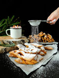 Khvorost cookies covered with sugar powder. Homemade khvorost cookies are being covered with sugar powder stock photography