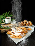 Khvorost cookies covered with sugar powder. Homemade khvorost cookies are being covered with sugar powder royalty free stock photos