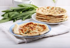 Khychiny – traditional caucasian flatbread filled with сheese and herbs royalty free stock photo