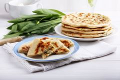 Khychiny – traditional caucasian flatbread filled with сheese and herbs royalty free stock image