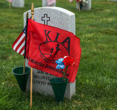KIA Flag. Killed in Action flag by a tombstone at an American National Cemetery Royalty Free Stock Image