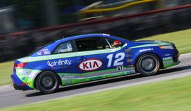 KIA Forte Koup racing Stock Images