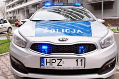 Kia Seed polish police car at the city street. Warsaw,Poland. 1 December 2017.  Kia Seed polish police car at the city street Royalty Free Stock Image