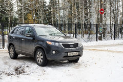 KIA Sorento parked in winter street in criminal district. Royalty Free Stock Photography