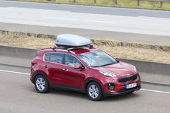 KIA Sportage with a roof box Royalty Free Stock Photography