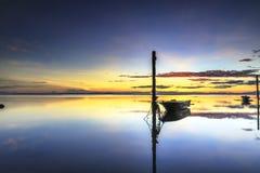 Kiamsam Beach, Labuan. Malaysia 01. Boat at Tanjung Aru beach Labuan Malaysia. with beautiful sunrise Royalty Free Stock Photo
