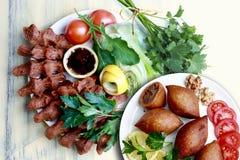 Kibbeh en Turkse cigkofte stock foto