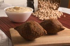 Kibbeh or Kibe, Quibe with Hummus. Close-up photo Stock Photo