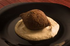 Kibbeh or Kibe, Quibe with Hummus. Close-up photo Stock Photography
