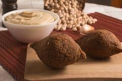 Kibbeh or Kibe, Quibe with Hummus. Close-up photo Royalty Free Stock Photography
