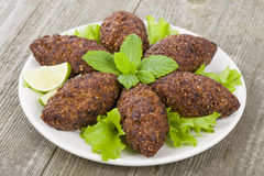 Kibbeh. Middle Eastern minced meat and bulghur wheat fried snack. Also popular party dish in Brazil (kibe Stock Image