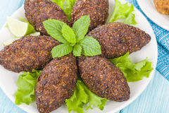 Kibbeh. Middle Eastern minced meat and bulghur wheat fried snack. Also popular party dish in Brazil (kibe Royalty Free Stock Images
