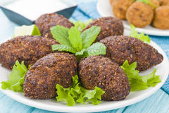 Kibbeh. Middle Eastern minced meat and bulghur wheat fried snack. Also popular party dish in Brazil (kibe Stock Photography