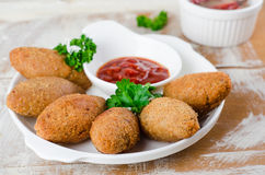 Kibbeh. Traditional Arabian meatballs with parsley in white plate on wooden background. Eastern cuisine. Selective focus Stock Photography