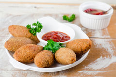 Kibbeh. Traditional Arabian meatballs with parsley in white plate on wooden background. Eastern cuisine. Selective focus Stock Photo