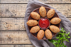 Kibbeh traditional middle eastern arabic lamb meat kofta meatball croquettes food. On vintage wooden table background Stock Photo