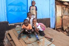 A group of poor children at a burnout hut in slums royalty free stock photography