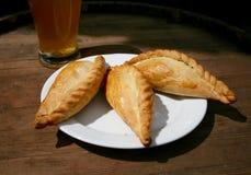 Kibinai traditionell lithuanian mat arkivfoton
