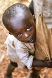 KIBUYE, RWANDA, AFRICA - SEPTEMBER 11, 2015: Unknown children. The little, timid African boy. Stock Images