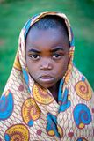 Kibuye/Rwanda - 08/25/2016: Dramatic look of African boy in Rwanda. Wrapped in patterened cloth royalty free stock photography