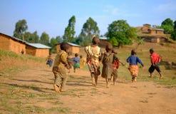 Kibuye/Rwanda - 08/25/2016: Group of african pygmy tribe children running and having fun in ethnic village royalty free stock image