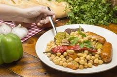 Kichererbseneintopfgericht mit Schweinefleisch lizenzfreie stockfotos