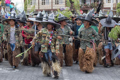 Kichwa men wearing chaps and military uniforms performing ritual. June 29, 2017 Cotacachi, Ecuador: kichwa indigenous men wearing chaps chanting and dancing on royalty free stock photography