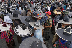 Kichwa men wearing extra large sombreros dancing on the street. June 29, 2017 Cotacachi, Ecuador: Kichwa men during occupy the main square event at Inti Raymi stock photos