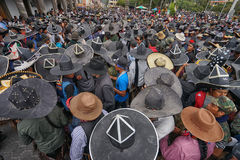 Kichwa men wearing extra large sombreros dancing on the street. June 24, 2017 Cotacachi, Ecuador: the streets at Inti Raymi celebration is filled with indigenous stock photography