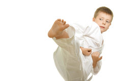 Kick. Karate boy making kick photo against white background with copyspace royalty free stock photo