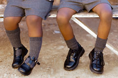 Kick. His and her school shoes, toughies on the step Royalty Free Stock Photo