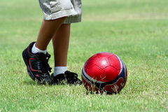 Kick The Ball. Boy running to kick the soccer ball Royalty Free Stock Images