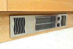 Kick Board Heater. A fan powered heater located in a kick board in a kitchen Stock Photo