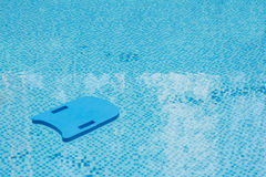 KIck board in swimming pool Royalty Free Stock Images